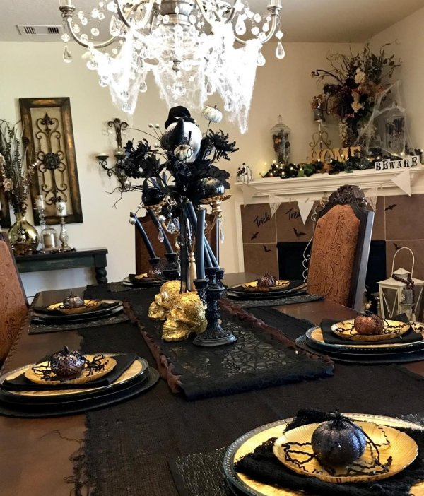 Glamorous table setting with spooky touch.