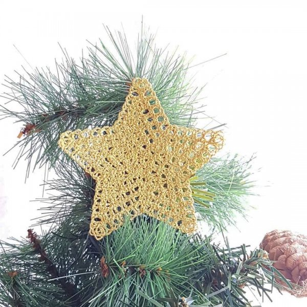 Golden thread used to make star Christmas tree ornaments.