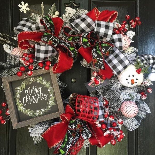 Gorgeous farmhouse Snowman wreath made by buffalo plaid fabric.