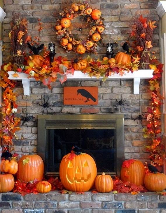 Gorgeous fireplace mantel decor with pumpkins.