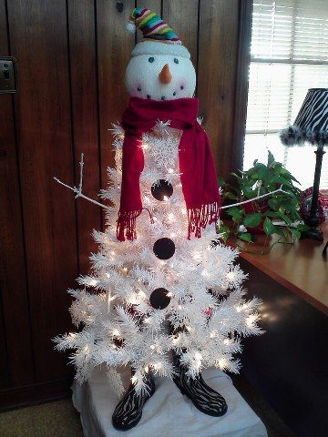 gorgeous white christmas tree in snowman character