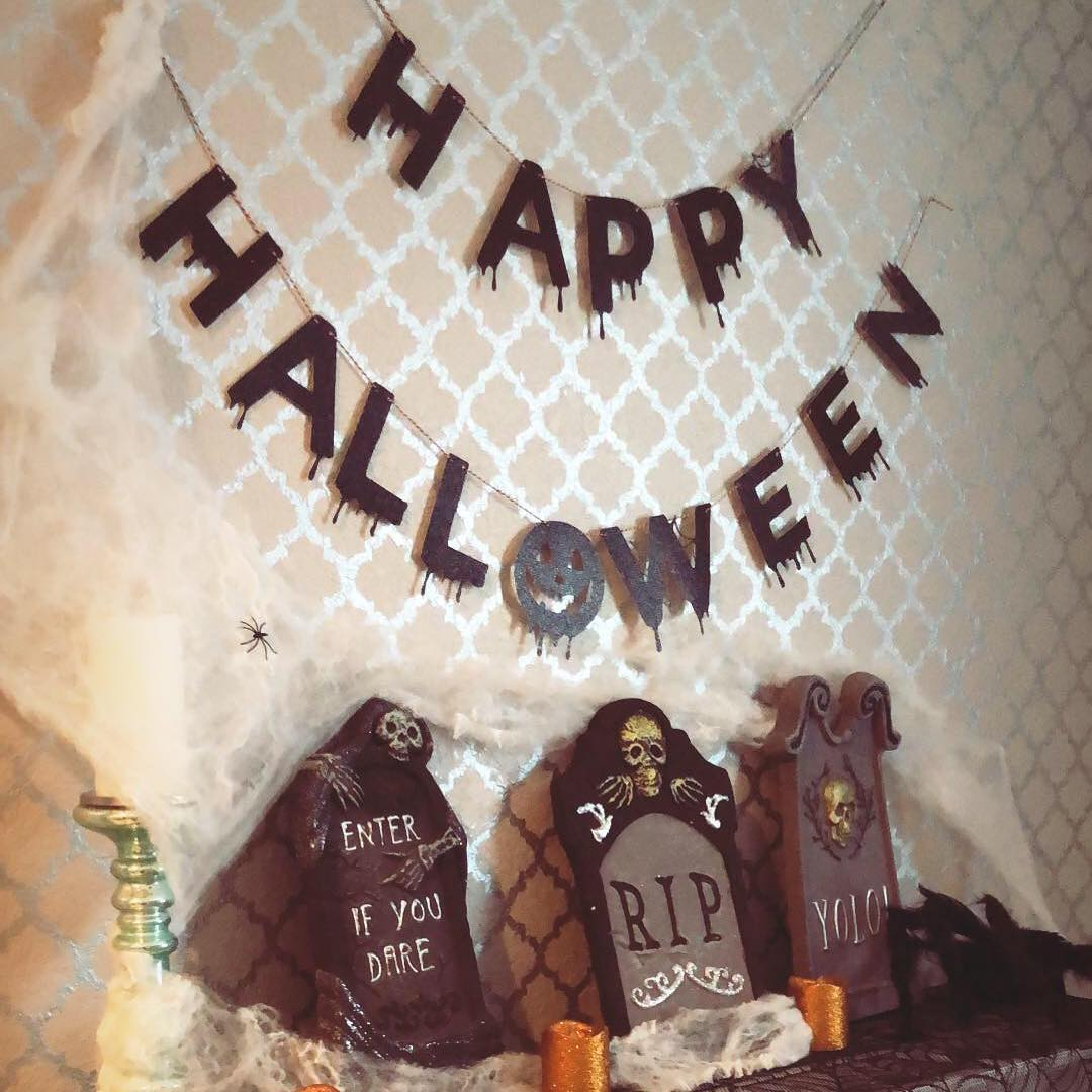 Graveyard with Happy Halloween banner to welcome your guests.