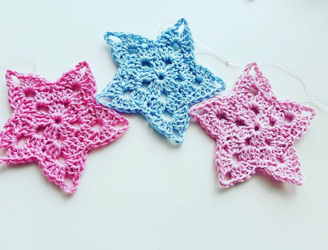 Handmade crochet blue and pink star tree ornaments.