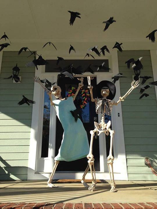 Hosts are ready to welcome the guest for Halloween party.