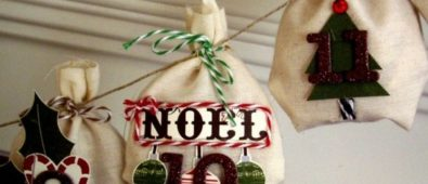 Impressive little cloth bags tied with bows are hung from a string that makes a Christmas garland.