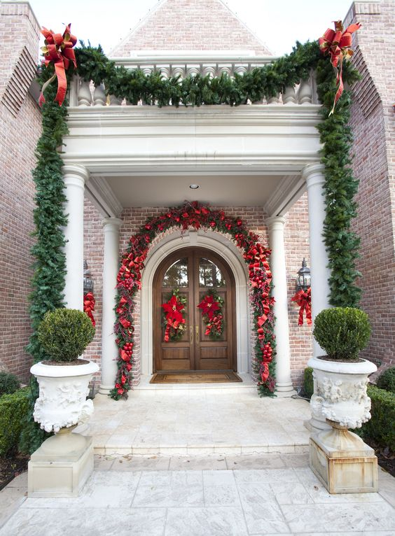 Incredible red and green theme porch decoration for Christmas.
