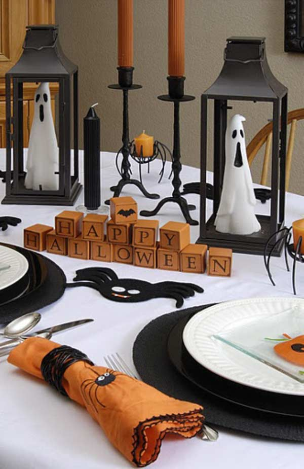 Lovely Halloween table decor from the ghosts inside the lanterns to the Happy Halloween blocks.