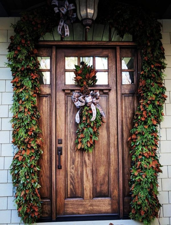 Marvellous door decor with real Magnolia leaves garland and wreath hanged by bowtie.