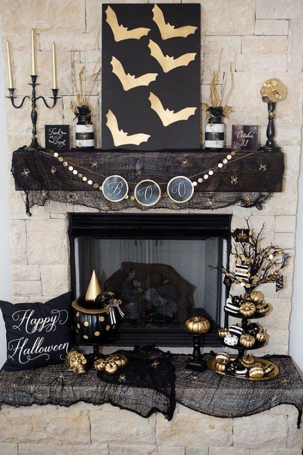 Marvelous black and golden halloween mantel.