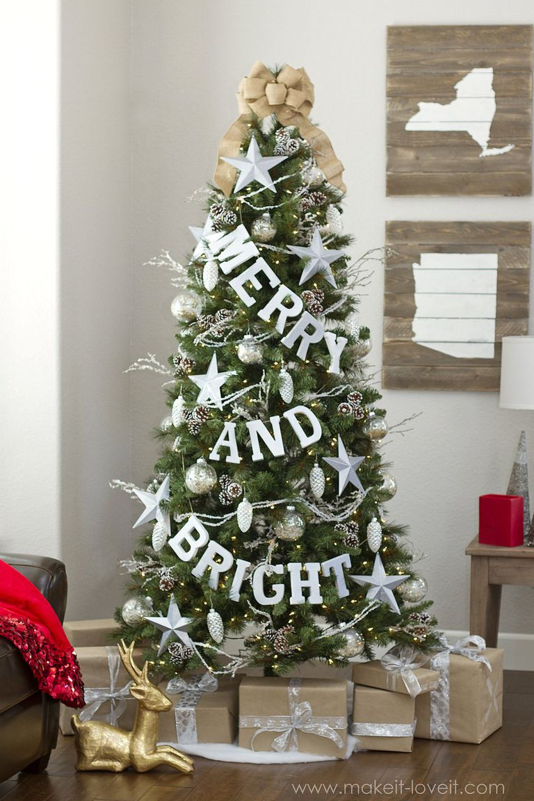 Merry and bright silver garland and ornament decoration with gifts and reindeer.