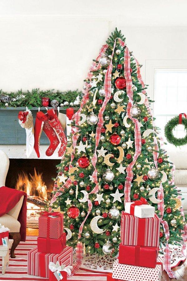 Modish moon and star ornaments on Christmas tree.