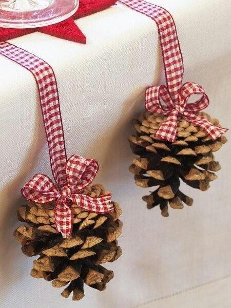 Natural pinecone hanged with plaided ribbon.