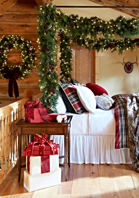 Nature lover Christmas bedroom decor with wreath, garland and lights.