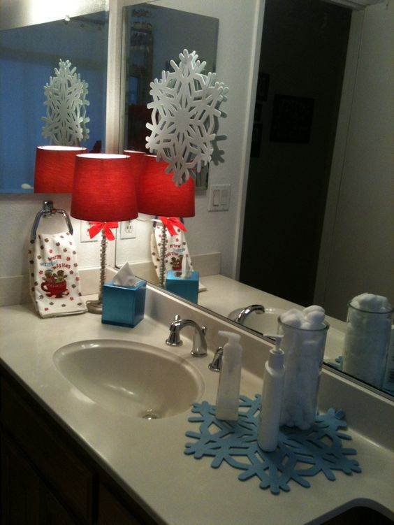 Nice bathroom decor with white snowflakes and red lampshade.
