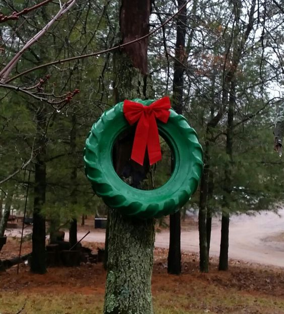 Old Tire is painted in Green and decorated with red ribbon.