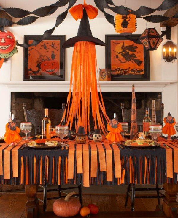 Orange and black crepe paper halloween decor.