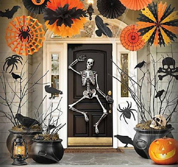 Paper crafts, crows, spider, pumpkin and skeleton on door perfect way to decorate entrance.