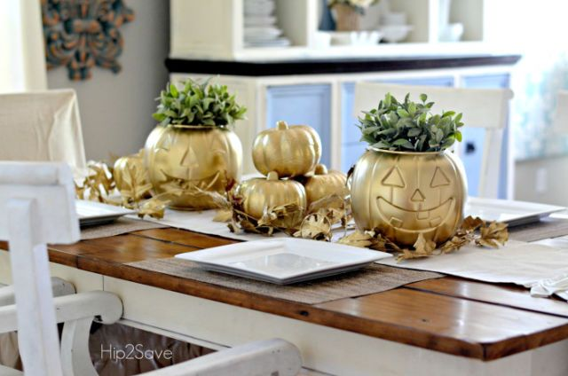 Plastic pumpkins stand out with some gold spray paint and pretty greenery.