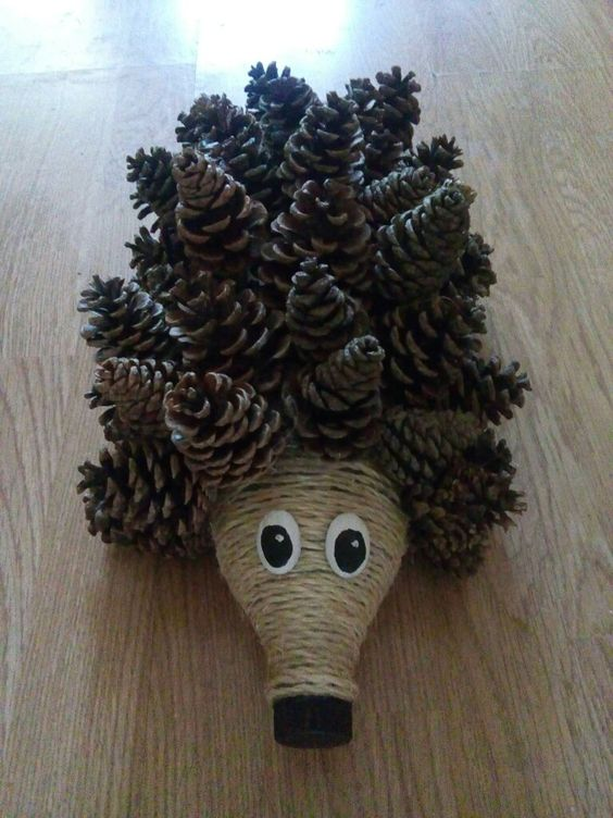 Pretty autumn hedgehog made by pinecones.