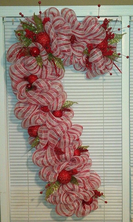 Pretty red and white stripes deco mesh candy cane for door.