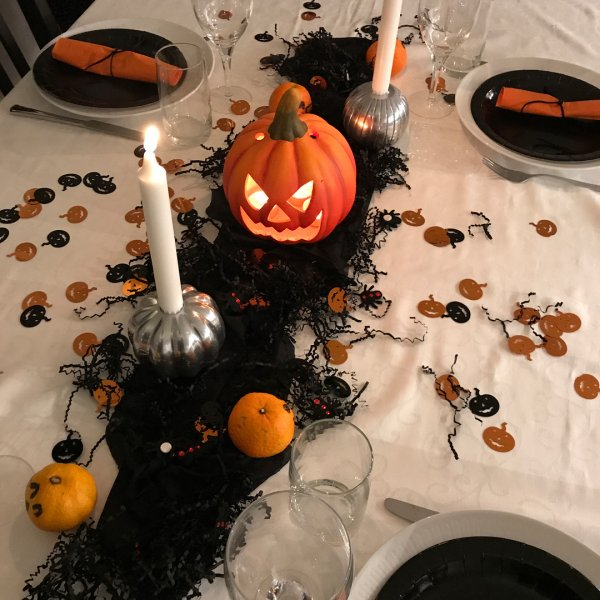 Pumpkin print table runner, silver pumpkin candle holder and spiders all looks great for spooky effect.