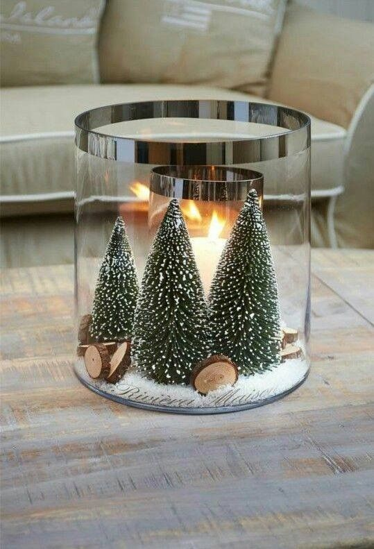 Put Christmas tree in glass jar with candles.