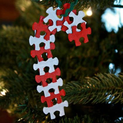 Puzzle pieces arranges as candy cane Christmas ornaments.