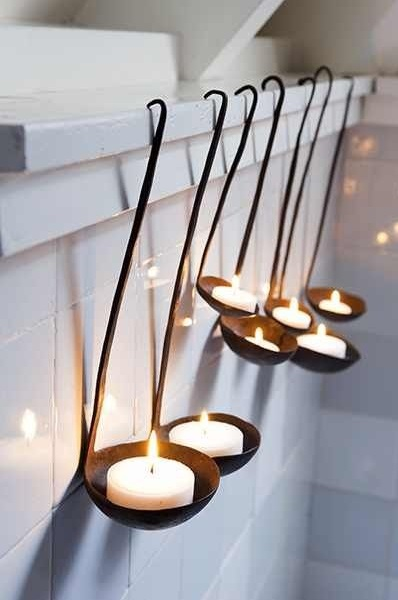 Recycled spoon candle holder.