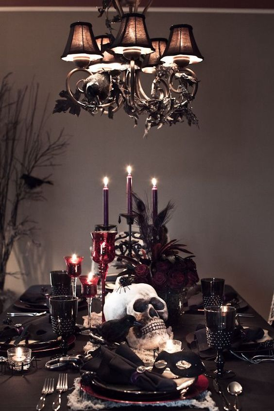 Red and black creepy Halloween table decoration idea.