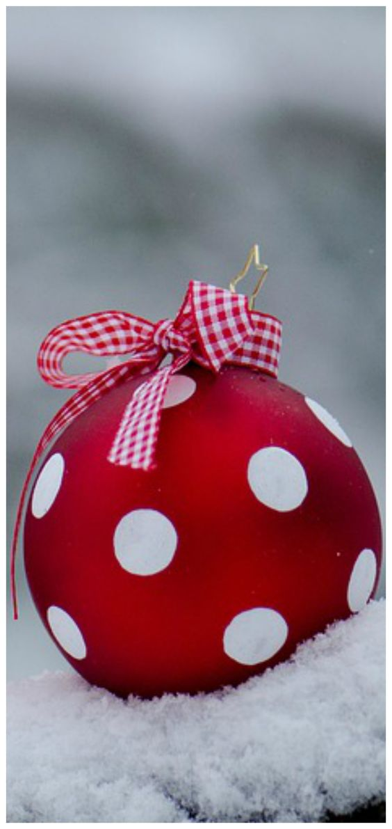 Red and white polka dot ball and stripe ribbon ornament for Christmas tree.