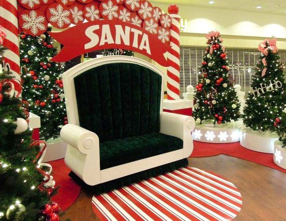 Red and white theme decor with wide Santa throne.