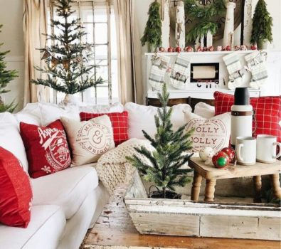 Red and white theme living room decor with table top Christmas tree.