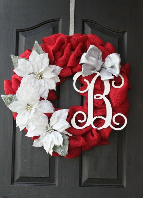 Red burlap with white big flower and letter.