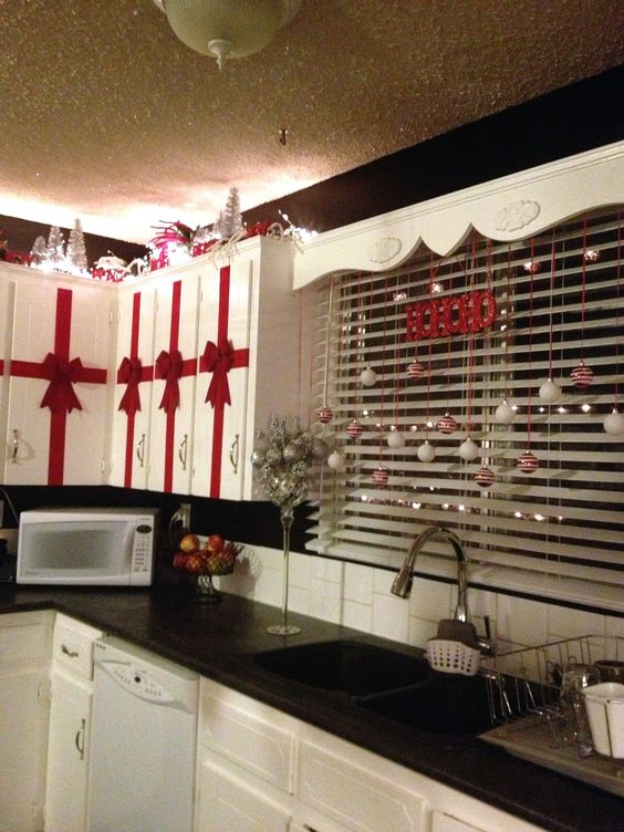 Red ribbon with velvet bow look amazing on cabinets.