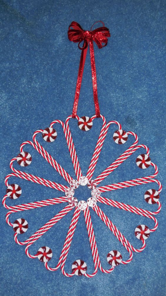 Reusable candy cane and peppermint wreath made by plastic ornaments and mints.