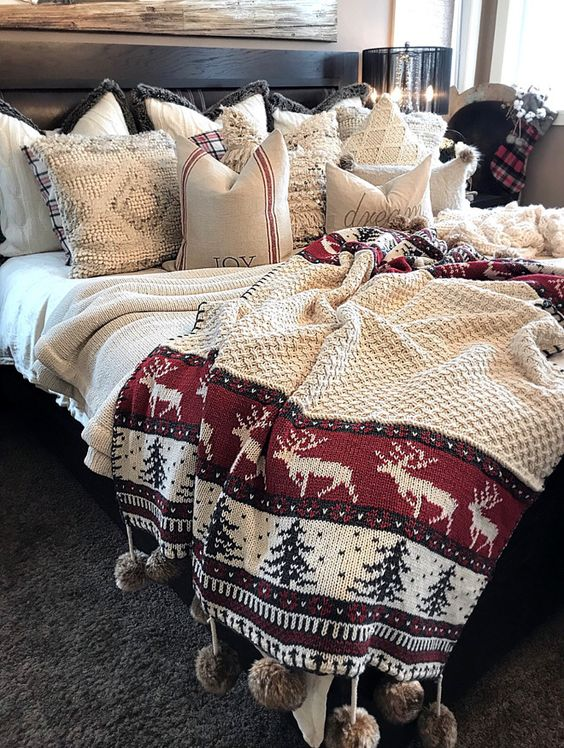 Rocking way to decorate bedroom with Christmas bedding, throws and pillows.
