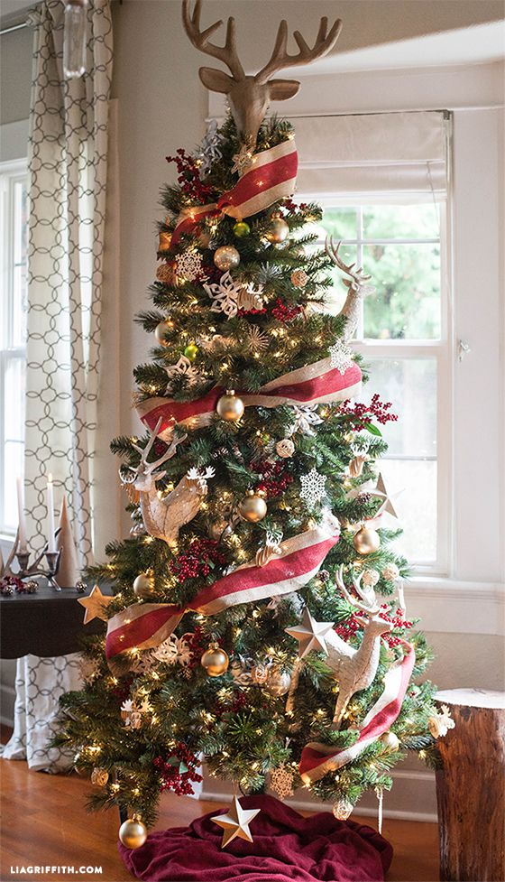 Royal Christmas tree decor with reindeer topper.