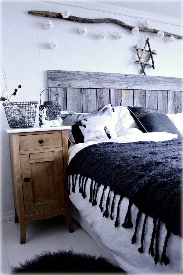 Rustic touch modern bedroom decoration with sea-shell garland, wooden star on wall ans reindeer on table.