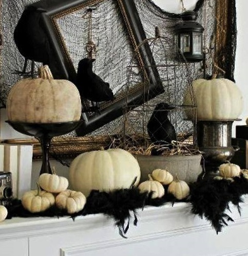 Scary Halloween Mantel decor with white pumpkins and crows.