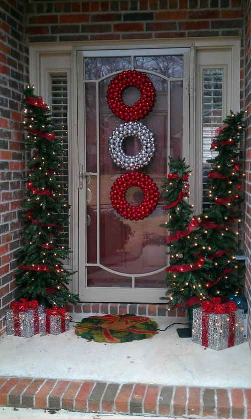 silver and red ornament wreath with christmas tree and gifts