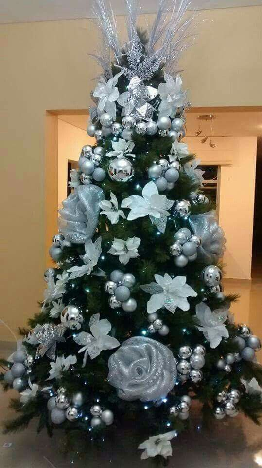 Silver flowers and ornament on this Christmas tree.