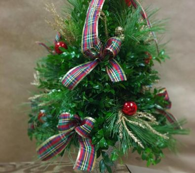 Simple mini Christmas tree decor with plaid ribbon and ornaments.