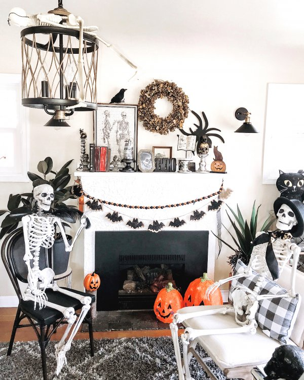 Skeleton are busy in discussion with this awesome mantel decor.