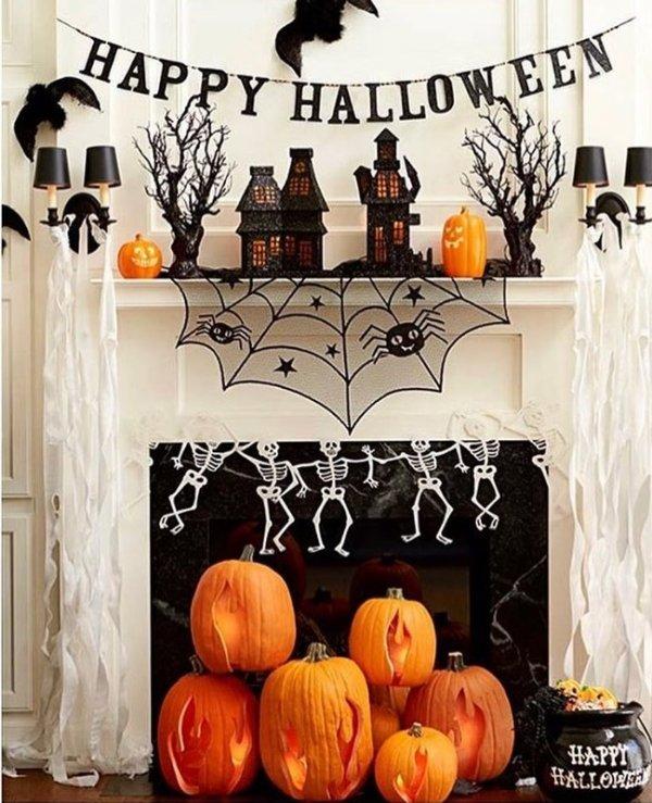 Skeleton garland, pumpkins, spiderweb for Happy Halloween.