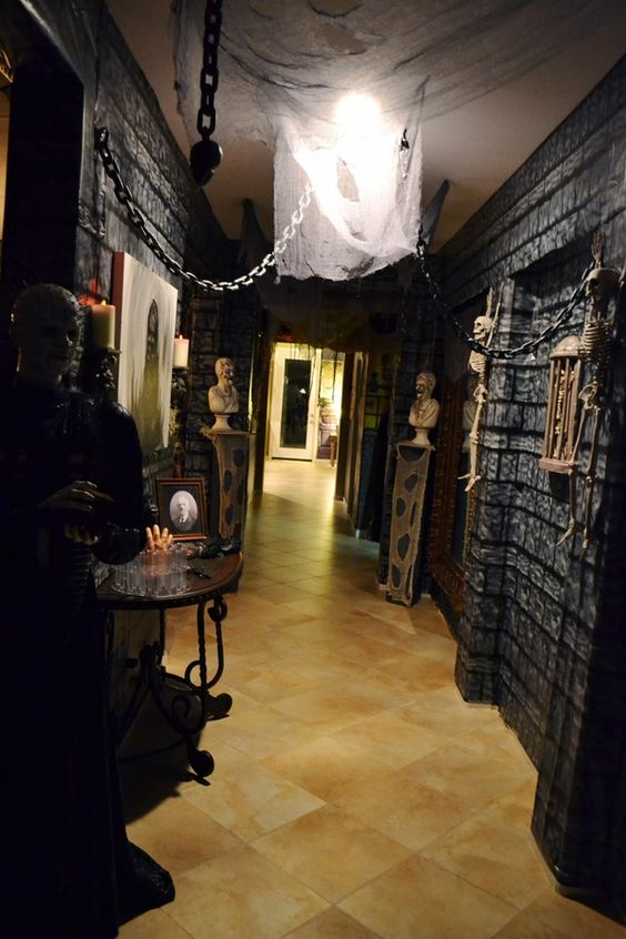 Skeletons are waiting in entry way to welcome the guests.