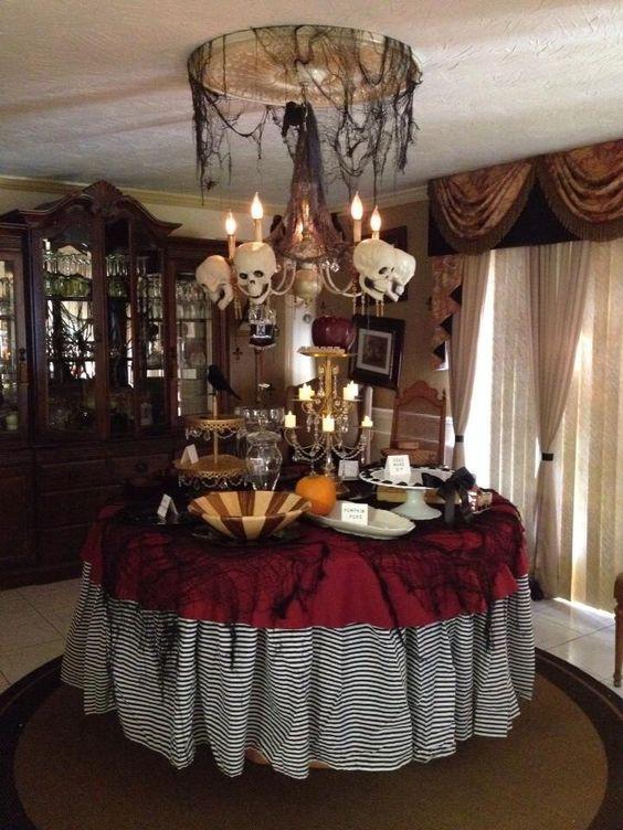 Skull chandelier looks amazing for Halloween dinner party.