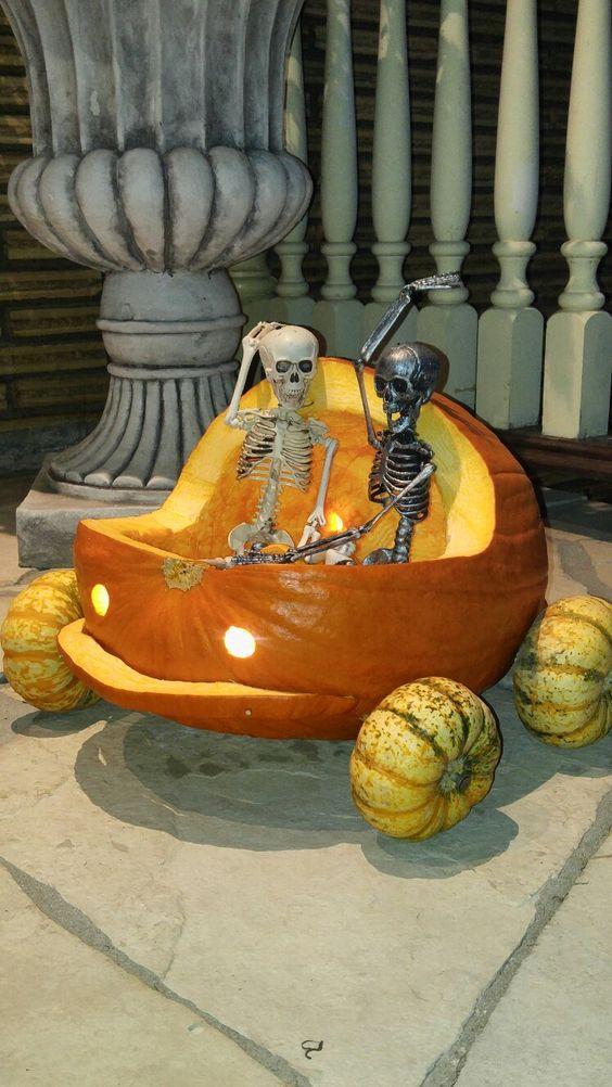Skull sitting in pumpkin.