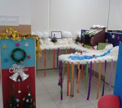 Snowy Office Cubicle Decoration With Cards And Ornaments.