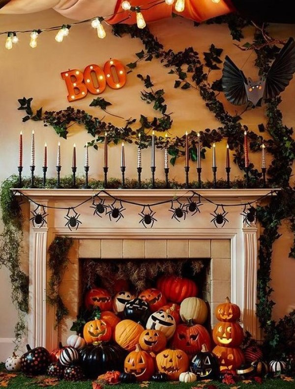 Spider garland, tree, bats, pumpkins and BOO to decorate to mantel for Halloween.