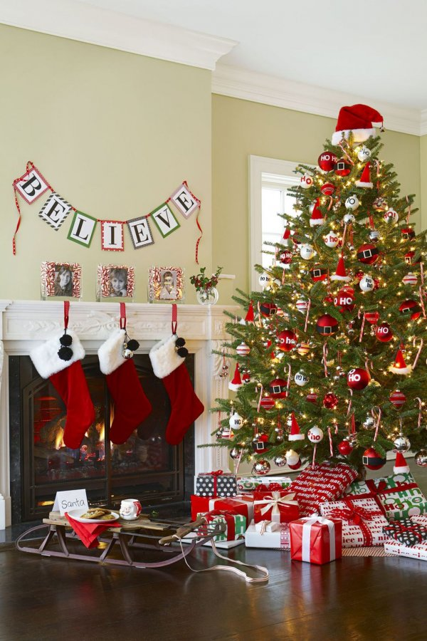 Stick to red and white ornaments, including candy canes, and top the tree with a fur-trimmed hat.